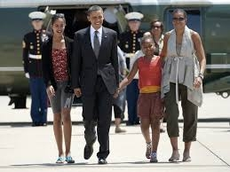 obama_first_family_aboard_air_force_1.jpg
